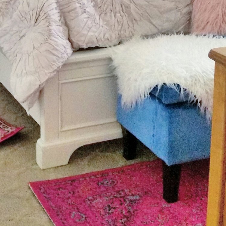 New ivory bedding, pink rugs and blue velvet covered bench.